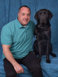 Jimmy Kriz - Fitness Showrooms Manager with his guide dog, Pete